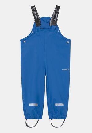 MUDDY UNISEX - Rain trousers - mittelblau