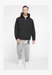 Jordan - M J JUMPMAN CLSCS LTWT PANT - Pantaloni sportivi - carbon heather/white - 6