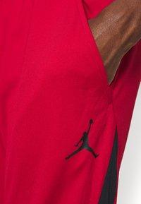 Jordan - AIR DRY PANT - Pantaloni sportivi - gym red/black - 3