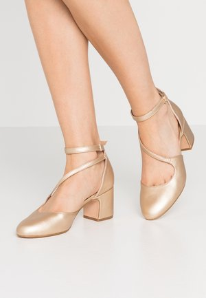 Klassieke pumps - light gold