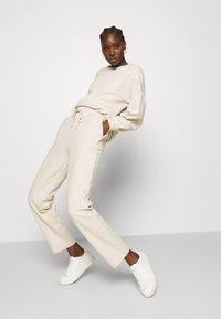 Lounge Nine - CESARINE PANTS - Trousers - pastel parchment melange - 4