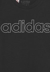 adidas Performance - UNISEX - Print T-shirt - black/white - 2