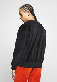 Carhartt WIP - UNITED SCRIPT - T-shirt à manches longues - black - 2