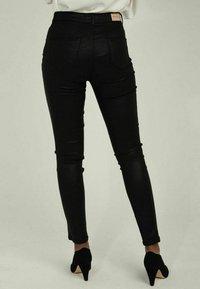 NAF NAF - Trousers - black - 2