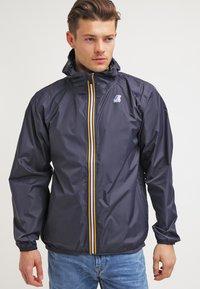 K-Way - LE VRAI CLAUDE UNISEX - Waterproof jacket - depth blue - 0