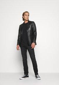 Diesel - THOMMER-X - Slim fit jeans - 069pw - 1