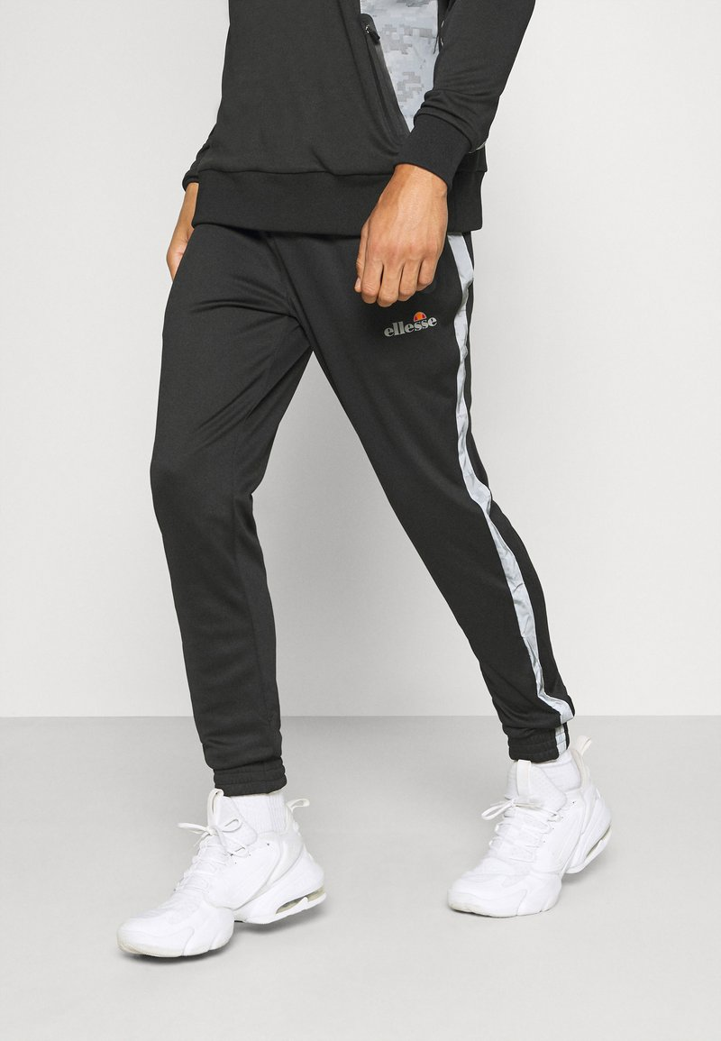 Ellesse - LOBIAT - Tracksuit bottoms - black