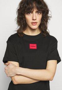 HUGO - NEYLETE REDLABEL - Jersey dress - black - 3