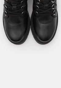 Unisa - JIMUL - Kotníkové boty na platformě - black - 5