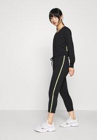 ONLY PLAY Petite - ONPADOR PANTS  - Pantalones deportivos - black - 1
