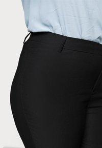 Vero Moda Curve - VMAUGUSTA SKINNY SOLID PANT - Leggings - Trousers - black - 4