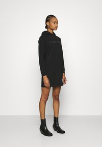 Calvin Klein - HOODED STUD DRESS - Day dress - black - 1