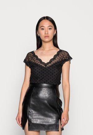 DARINA - T-shirt med print - noir