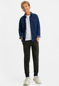 WE Fashion - Tracksuit bottoms - dark blue - 1