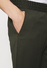 Filippa K - TERRY CROPPED TROUSER - Trousers - moss green - 5