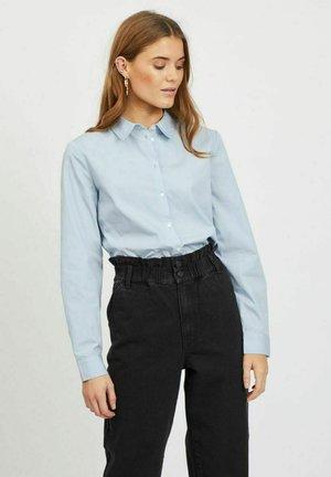 VIGAMI  - Button-down blouse - cashmere blue