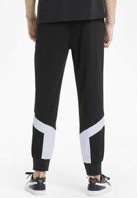 Puma - ICONIC MCS - Pantalon de survêtement - puma black - 2