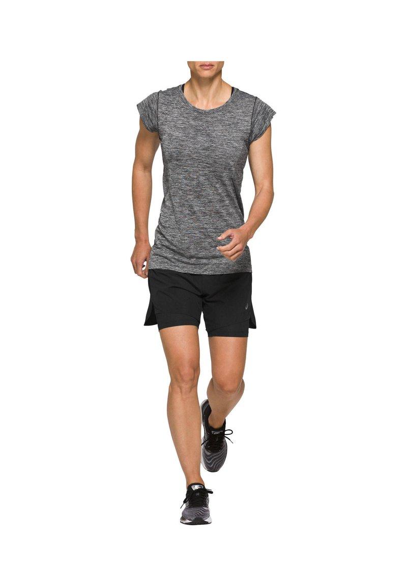 ASICS - RACE SEAMLESS  - Camiseta básica - schwarz (200)