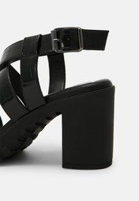 Buffalo - VEGAN RAGAN - Platform sandals - black - 5
