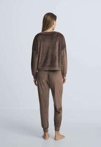 OYSHO - Tracksuit bottoms - brown - 2