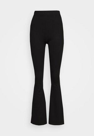 FLARE PANT - Leggings - black