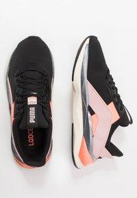 Puma - LQDCELL SHATTER XT GEO - Sports shoes - black/peachskin/peach - 1