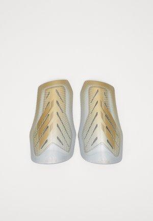 X SG PRO - Fotbollsbenskydd - white/gold/silver