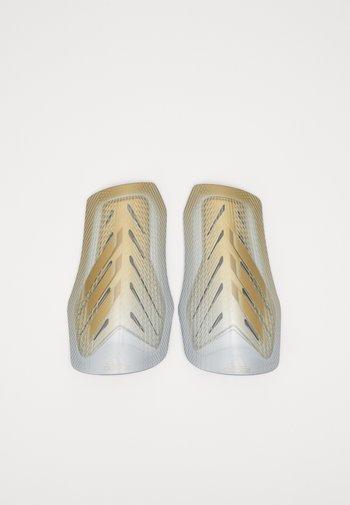 X SG PRO - Shin pads - white/gold/silver