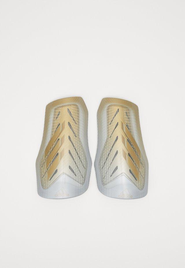 X SG PRO - Leggbeskyttere - white/gold/silver
