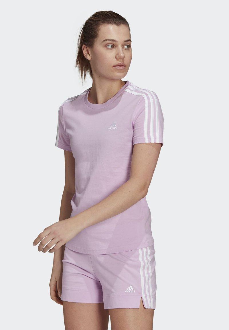 adidas Performance - T-shirts med print - purple