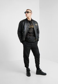 Versace Jeans Couture - GIUBBETTI UOMO - Bomberjacke - nero - 1