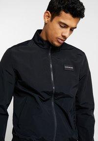 Calvin Klein Jeans - ZIP UP HARRINGTON - Bomber Jacket - black - 3