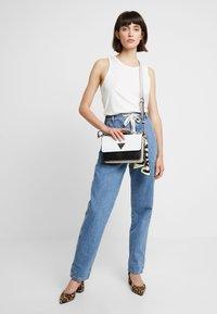Guess - ANALISE CROSSBODY FLAP - Handbag - white - 1