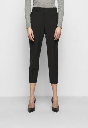 TREECA - Trousers - black
