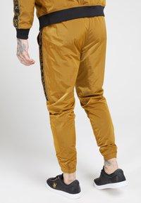 SIKSILK - TAPED JOGGERS - Tracksuit bottoms - golden mustard - 2