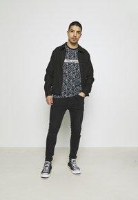 Tommy Jeans - MILES SKINNY - Jeans Skinny Fit - denim - 1