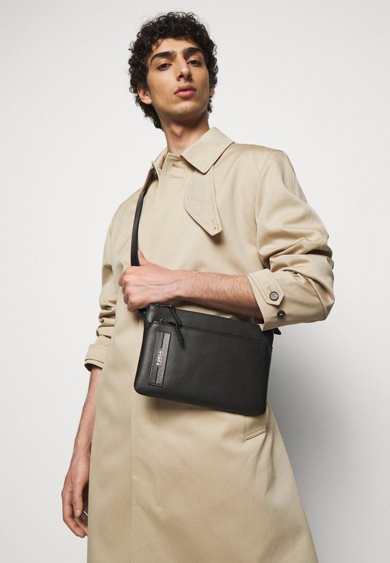 Furla - TECHNICAL CROSSBODY POUCH UNISEX - Across body bag - nero