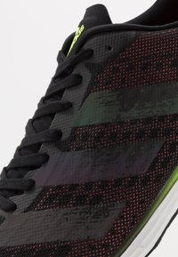 adidas Performance - ADIZERO ADIOS  - Competition running shoes - core black/signal green - 5