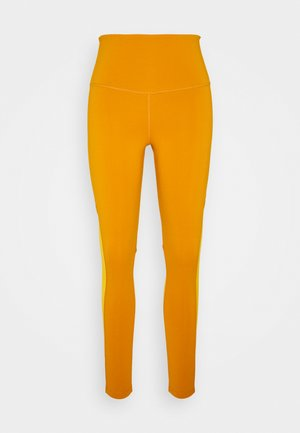 BEYOND THE SWEAT - Tights - radiant ochre