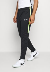 Nike Performance - ACADEMY PANT WINTERIZED - Tracksuit bottoms - black/volt - 0