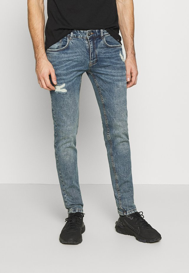 STOCKHOLM DESTROY - Jeans slim fit - hola blue