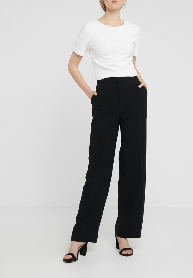 HUTTON TROUSERS - Kangashousut - black