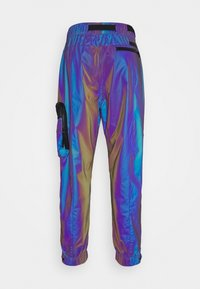 Calvin Klein Jeans - FASHION IRIDESCENT PANT - Tracksuit bottoms - purple - 1