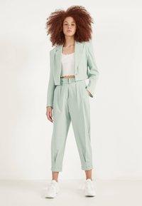 Bershka - SLOUCHY - Trousers - turquoise - 1