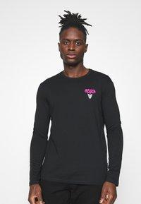 YOURTURN - UNISEX - Long sleeved top - black - 0