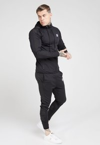 SIKSILK - CREASED PANTS - Spodnie treningowe - black - 1
