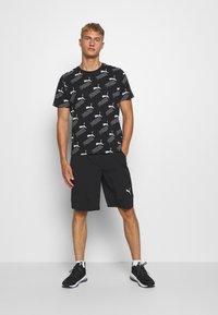 Puma - AMPLIFIED TEE - Print T-shirt - black - 1