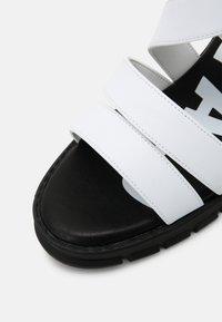 Buffalo - VEGAN RAGAN - Platform sandals - white - 5
