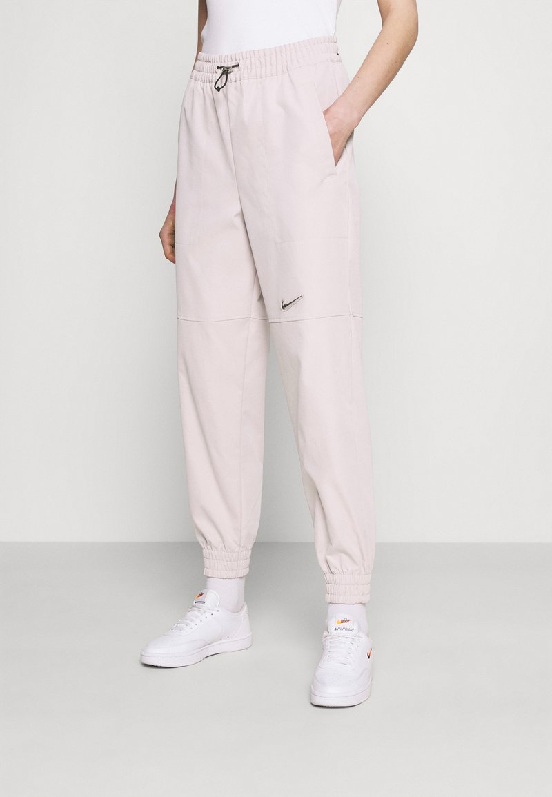 Nike Sportswear - PANT - Tracksuit bottoms - champagne