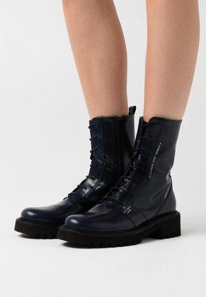 Platform ankle boots - poncho sirena